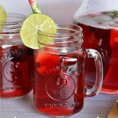 Mason jar mug with red berry punch for Memorial day