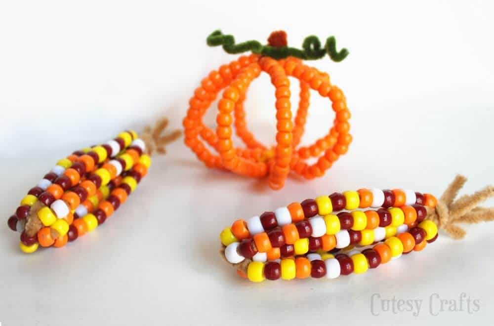 Thanksgiving crafts - pony beads made into harvest corn and pumpkin shapes