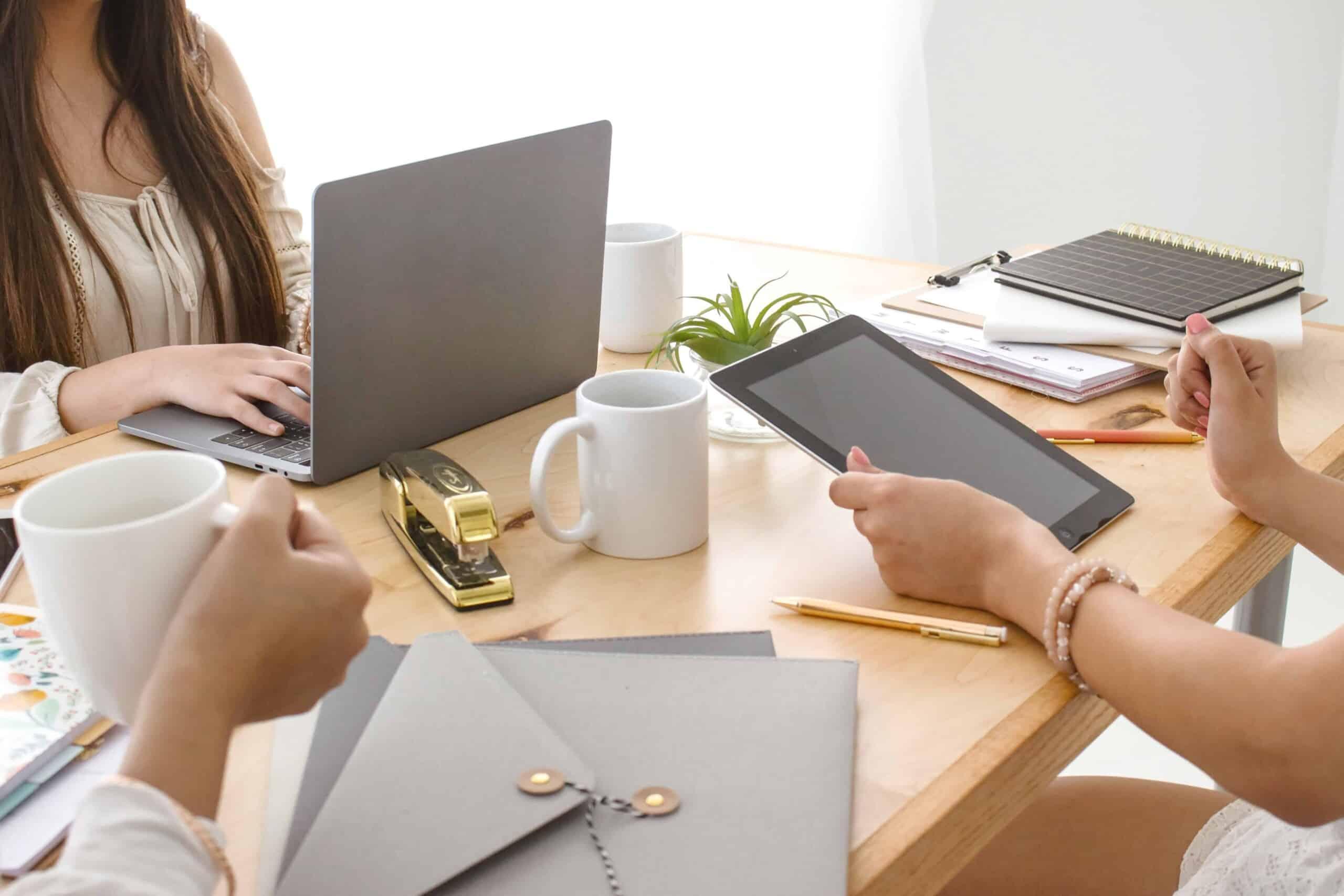 Female entrepreneurs working together at desk.