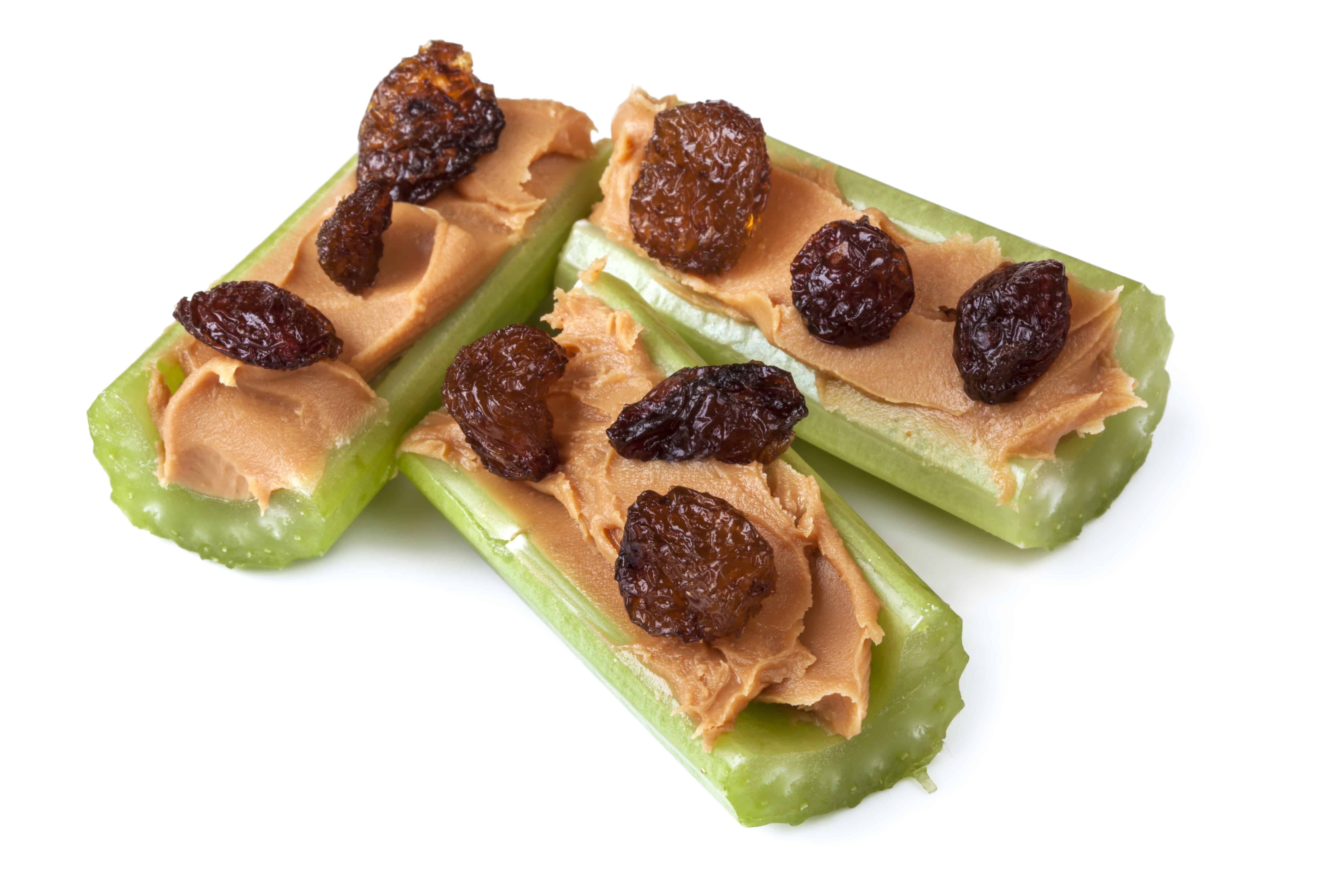 Easy after school snack of celery with peanut butter and raisins