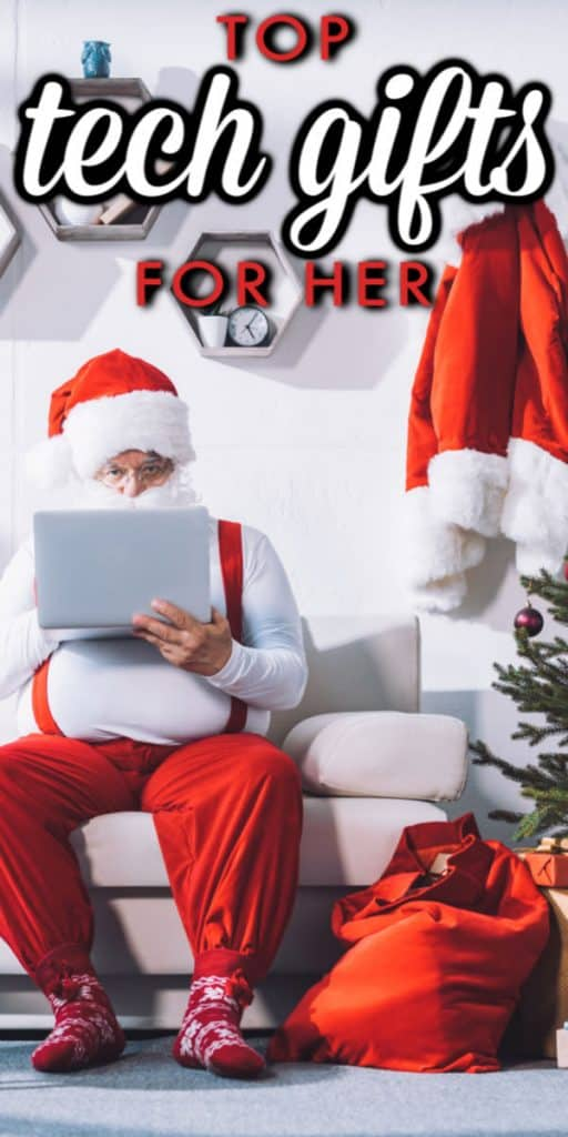 Santa on a laptop next to christmas tree