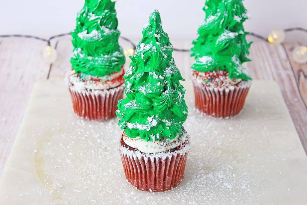 Christmas tree cupcakes on white countertop