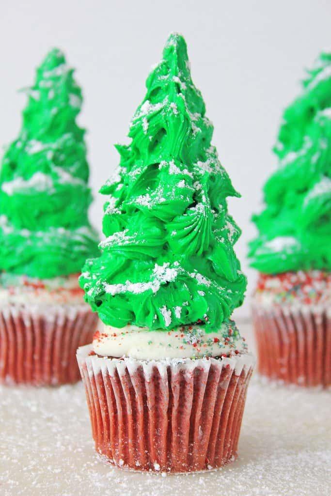 Christmas tree cupcakes on white white countertop