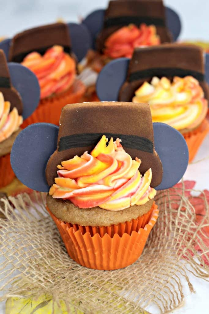 Thanksgiving cupcakes displayed on table with leaves