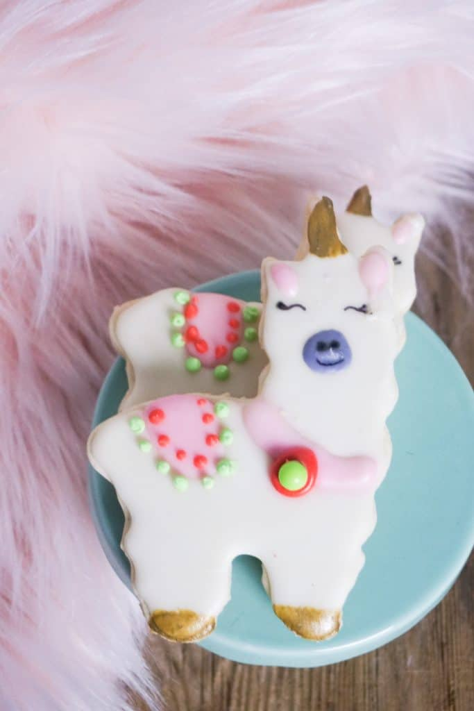 llama cookies on blue plate with pink fur