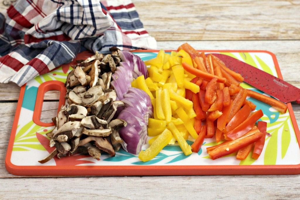 Veggies cut up on cutting board for Cajun creamy chicken pasta.