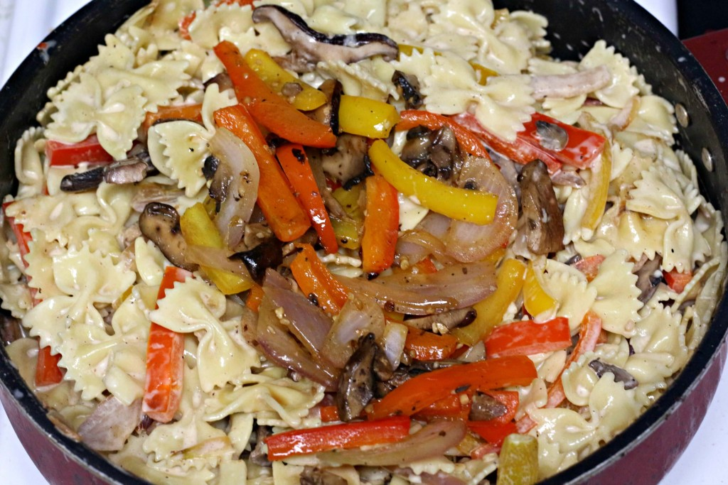 Noodles added into skillet with veggies after sauteing.