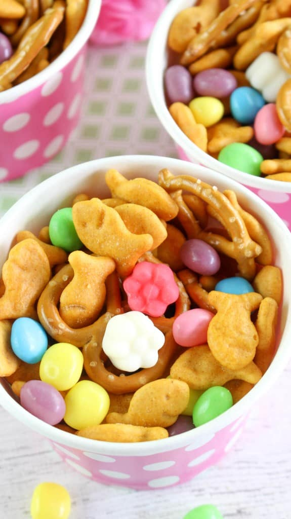 Spring snack mix in pink and white polka dot cups on table.