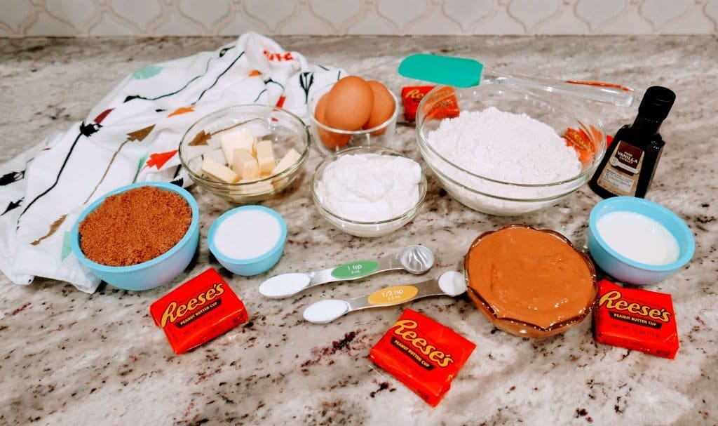Ingredients to make Nutella Reese's Cupcakes on marble countertop